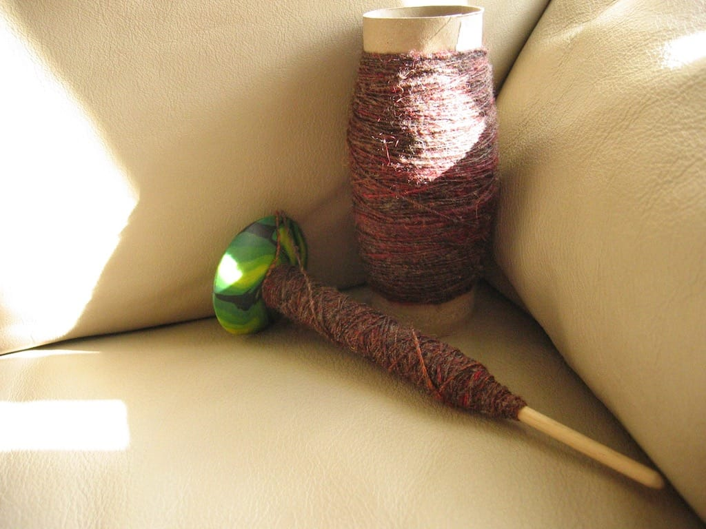 Spun yarn on a drop spindle.