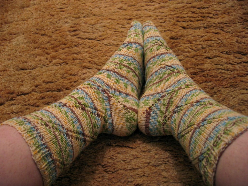 A pair of hand-knit socks.