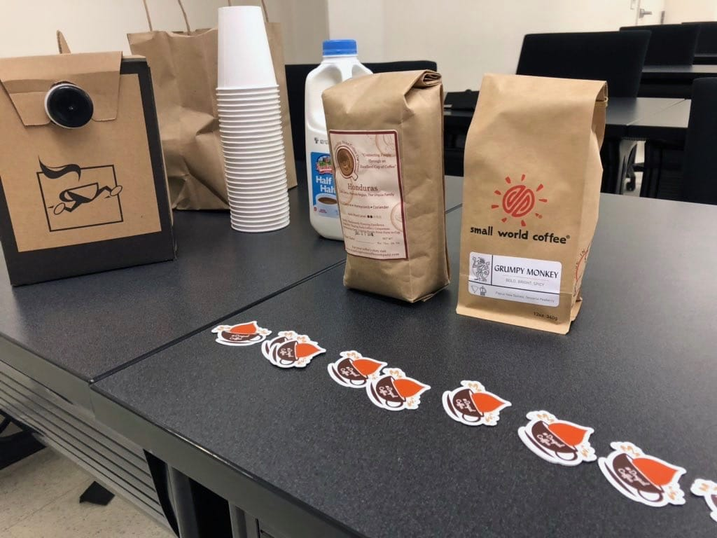 Coffee bags on a table in a conference room.