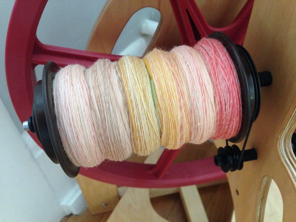 Sushi colored yarn in progress on my spinning wheel.