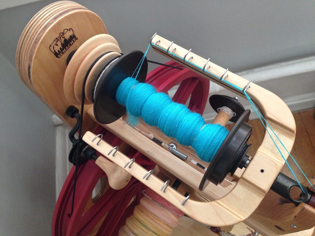 Teal yarn in progress on my spinning wheel.