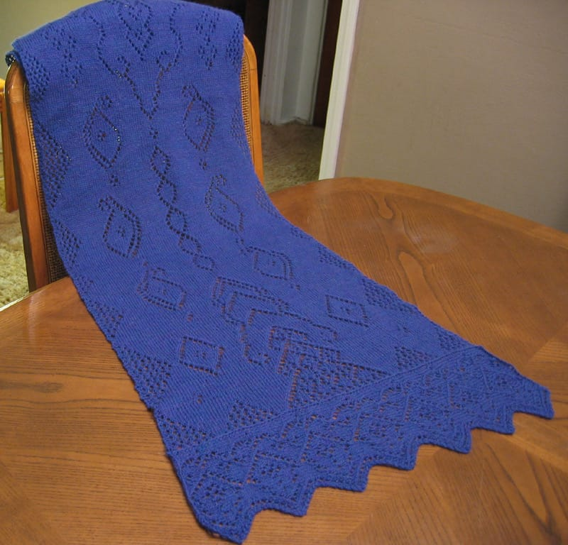 A shawl on a table.