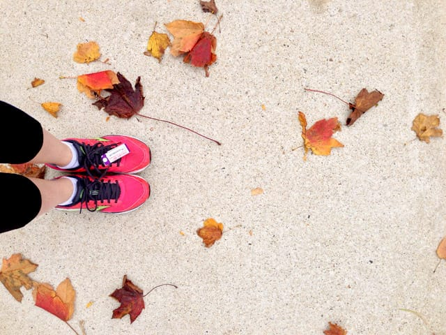 Running shoes on the sidewalk, ready to run a 5k.