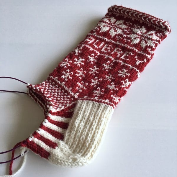 The foot of a hand-knit stocking, still in progress.