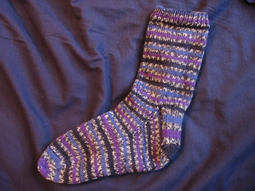 A finished purple striped sock.